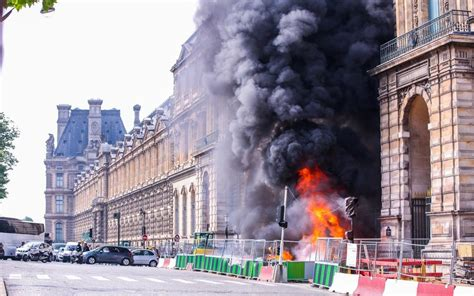 Fire rages outside Paris' Louvre as museum is still closed