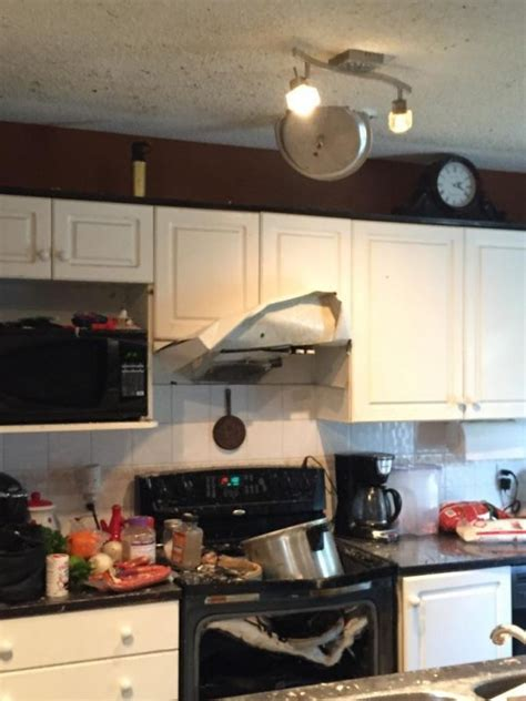 Photo of a kitchen damaged by a pressure cooker explosion