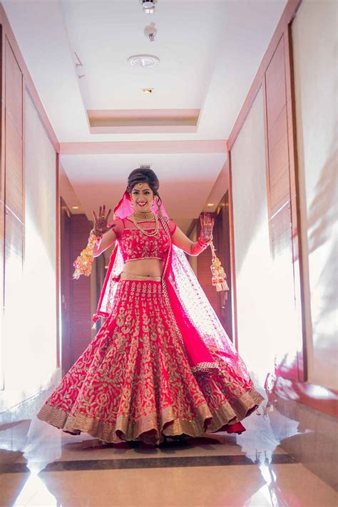 Photo of Bride in Pink and Gold Bridal Lehenga with Kaleere